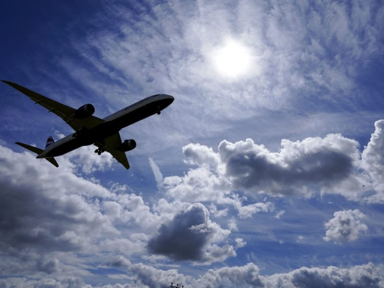 PCR testing will remain mandatory for travellers arriving in Scotland (PA)