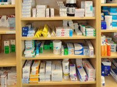 Medicines and drugs on a shelf in a pharmacy (Ben Birchall/PA)