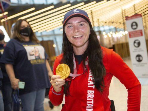 Gold medalist Lauren Rowles arrives back at London Heathrow (Rick Findler/PA)