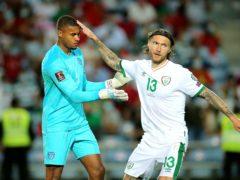 Republic of Ireland midfielder Jeff Hendrick (right) congratulates keeper Gavin Bazunu on his penalty save from Cristiano Ronaldo (Isabel Infantes/PA)