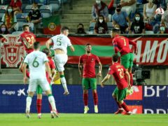John Egan, wearing number five, is convinced there is more to come from the Republic of Ireland after Cristiano Ronaldo's enduring brilliance condemned them to a heart-breaking World Cup qualifier defeat (Isabel Infantes/PA)