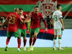 Cristiano Ronaldo (centre) broke the international goals record to crush Ireland hopes (Isabel Infantes/PA)