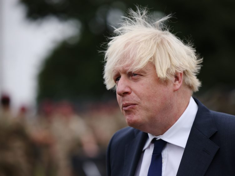 Prime Minister Boris Johnson speaks to media during a visit to Merville Barracks in Colchester, Essex, to meet members of 16 Air Assault Brigade, following their recent deployment to Afghanistan to enable the safe evacuation of British nationals and Afghans who worked alongside British forces and who had been given the right to settle in the UK (Dan Kitwood/PA)