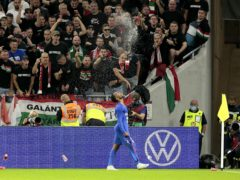 Supporters throw cups at Raheem Sterling after he scored England's opening goal in Budapest (Attila Trenka/PA)