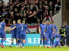 England's Raheem Sterling (right) celebrates opening the scoring in Budapest (Attila Trenka/PA).