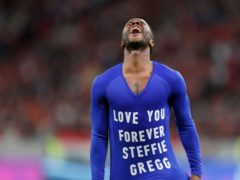 England's Raheem Sterling takes off his jersey to pay tribute to Steffie Gregg (Laszlo Balogh/AP)