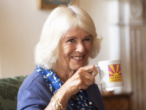 The Duchess of Cornwall takes a drink during a meeting with young women (Eddie Mulholland/Daily Telegraph)