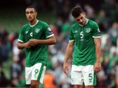 Republic of Ireland's John Egan and Adam Idah, left, appear dejected after the World Cup qualifier draw with Azerbaijan (Niall Carson/PA)