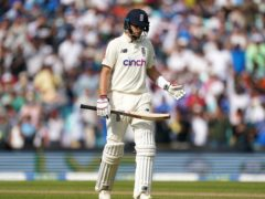 England's Joe Root reacts after being bowled out by India's Shardul Thakur (Adam Davy/PA)