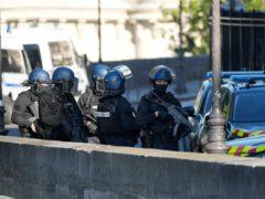 Security forces patrol outside the Palais de Justice in Paris (Francois Mori/AP)