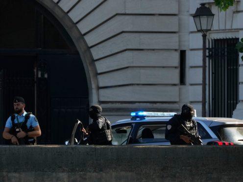 Security forces outside the Palais de Justice in Paris (Francois Mori/AP)
