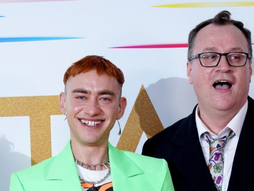 It's A Sin creator Russell T Davies, right, pictured with show star Olly Alexander, has revealed a TV executive dismissed the hard-hitting series as 'that miserable Aids drama' (Ian West/PA)