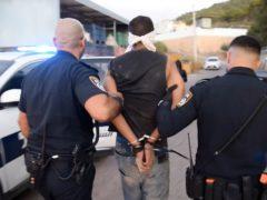 Palestinian fugitive Zakaria Zubeidi is arrested by Israeli police officers, in Umm al Ghanam, northern Israel (AP)