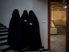 Women stand inside an auditorium at Kabul University's education centre during a demonstration (Felipe Diana/AP)