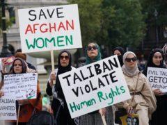 People at an Afghanistan solidarity rally in Trafalgar Square (Yui Mok/PA)