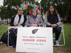 Three Afghan mothers (names withheld) who have been on hunger strike since Thursday September 9 – in protest against the Taliban takeover of Afghanistan – in Parliament Square (Yui Mok/PA)