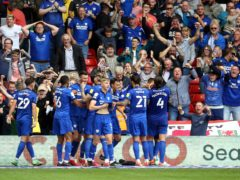 Rubin Colwill and his Cardiff team-mates celebrate his winner at Nottingham Forest (Nigel French/PA)