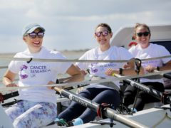 From left, Kat Cordiner, Charlotte Irving and Abby Johnston preparing to take part in the the Talisker Whisky Atlantic Challenge (Cancer Research UK/PA)