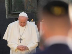Pope Francis prays as he meets members of the Jewish community (Gregorio Borgia/AP)