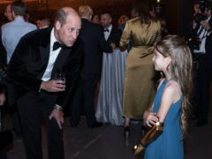 The Duke of Cambridge speaks with Phoebe Sinclair, aged nine, at The Sun's Who Cares Wins Awards (Arthur Edwards/The Sun)