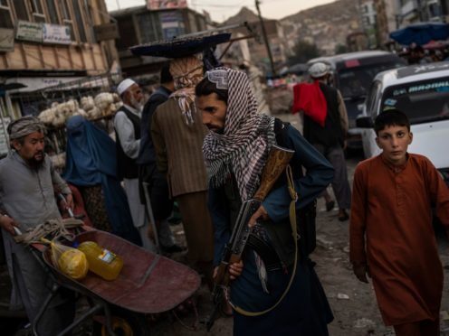 Taliban fighters patrol a market in Kabul (Bernat Armangue/AP)
