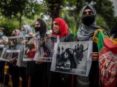 Afghan women hold placards during a protest against Pakistan and the Taliban takeover of Afghanistan, in New Delhi, India (AP)