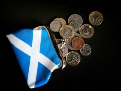 The Scottish economy is now forecast to return to pre-pandemic levels faster than expected (Jane Barlow/PA)