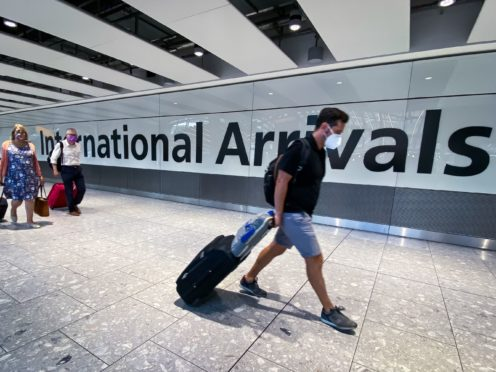 An expert advising the Government said the relaxation of travel rules will increase the risk around coronavirus (Aaron Chown/PA)