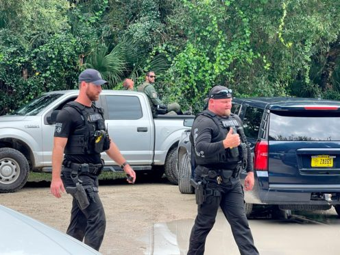 Law enforcement officials conduct a search of the vast Carlton Reserve in the Sarasota (North Port Police Department via AP)