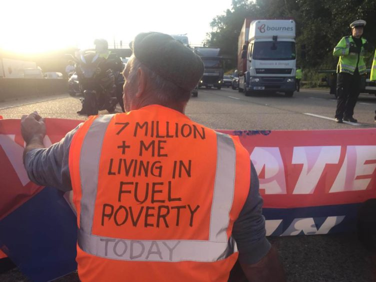 Insulate Britain protesters occupying the clockwise and anti-clockwise lanes on the M25 in Surrey on Tuesday (Insulate Britain/PA)