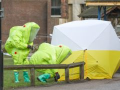 File photo dated 08/03/18 of personnel in hazmat suits working to secure a tent covering a bench in the Maltings shopping centre in Salisbury, where former Russian double agent Sergei Skripal and his daughter Yulia, were found critically ill by exposure to Novichok nerve agent. A third Russian spy faces charges of attempted murder over the Salisbury Novichok poisonings. (Andrew Matthews/PA) Issue date: Tuesday September 21, 2021.