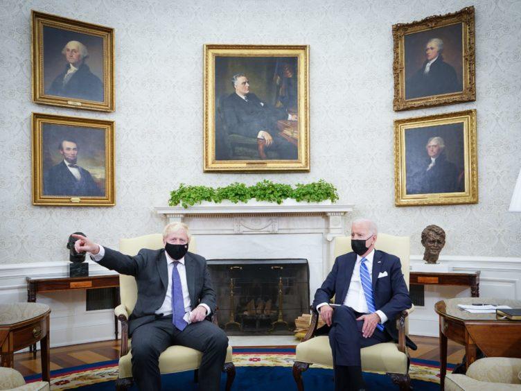 Prime Minister Boris Johnson meets US President Joe Biden in the Oval Office (Stefan Rousseau/PA)