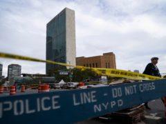 A pedestrian passes police barricades surrounding the United Nations headquarters (John Minchillo/AP)