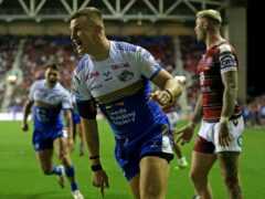 Ash Handley celebrates after scoring Leeds' try (Nigel French/PA)