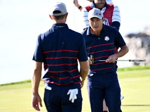 Team USA's Collin Morikawa (right) was a winner in the opening session of the 143rd Ryder Cup (Anthony Behar/PA)