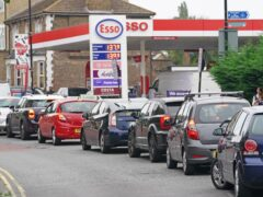 Motorists queue at an Esso petrol station in Brockley, south London (Dominic Lipinski/PA)
