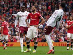 Bruno Fernandes, centre, reacts after missing a late penalty after Villa goalscorer Kortney Hause, left, handled (Martin Rickett/PA)