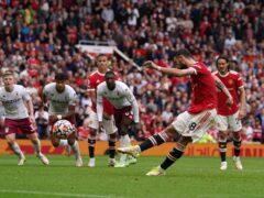 Bruno Fernandes sends his penalty high over the bar against Aston Villa (Martin Rickett/PA)