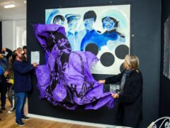 A painting of the Beatles by artist Jonathan Hague is unveiled at the Beatles Museum in Liverpool (Peter Byrne/PA)