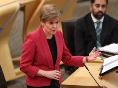 First Minister Nicola Sturgeon was challenged on the 'spiralling crisis' in Scotland's NHS (Russell Cheyne/PA)