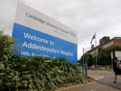 The woman, who cannot speak, is on a ventilator at Addenbrooke's Hospital in Cambridge (PA)