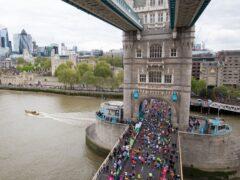 Runners cross Tower Bridge during the 2019 Virgin Money London Marathon (PA)
