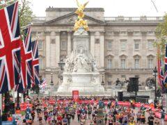 Runners near the finish line during the 2019 Virgin Money London Marathon (PA)