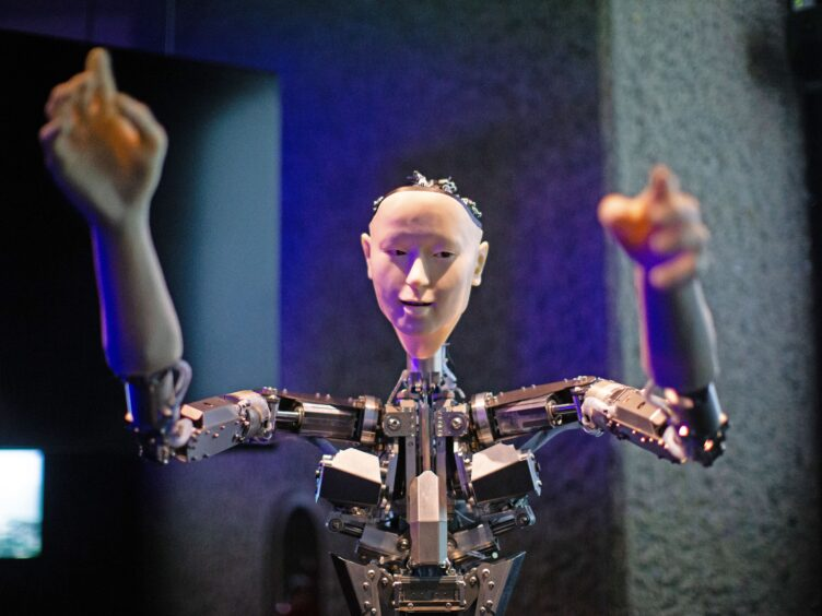 Roboticist Hiroshi Ishiguro's 'Alter', a machine body with a human like face and hands who learns through interplaying (Aaron Chown/PA)