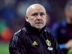 Mike Phelan has extended his stay at Manchester United (Mike Egerton/PA)