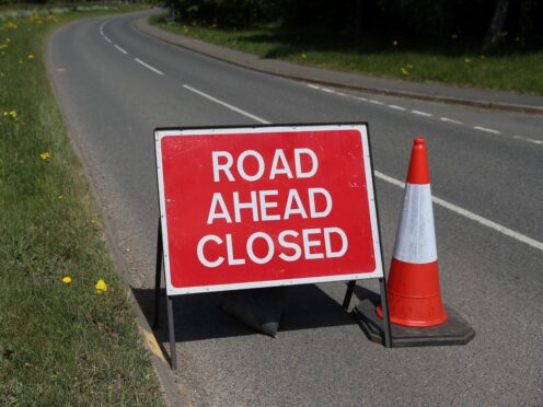 The road was closed for several hours while police investigated the crash (David Davies/PA)