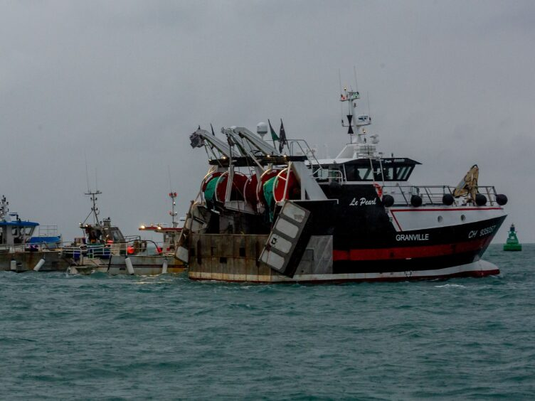 French fishing vessels protesting outside the harbour at St Helier, Jersey (Gary Grimshaw/Bailiwick Express/PA)