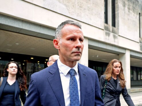 Former Manchester United footballer Ryan Giggs leaves Manchester Crown Court (Peter Byrne/PA)