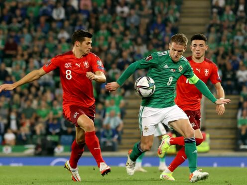 Northern Ireland and Switzerland will resume battle in the race for second place in Group C on Saturday (Liam McBurney/PA)