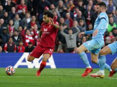 Liverpool's Mohamed Salah scores their side's second goal of the game during the Premier League match at Anfield, Liverpool. Picture date: Sunday October 3, 2021.